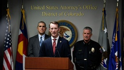 "U.S. Attorney Jason R. Dunn, center, speaks during a press conference at U.S. Attorney's Office on November 4, 2019 in Denver, Colorado. The FBI announced that they arrested Richard Holzer on domestic terrorism charges for his plot to blow up Temple Emanuel Synagogue in Pueblo. The 27-year-old Pueblo man, who hoped to incite a racial holy war and plotted ways he could destroy the second-oldest synagogue in Colorado to ""get that place off the map,"" is accused of domestic terrorism and a hate crime by federal authorities. With Dunn at the podium are Dean Phillips, FBI Denver Division Special Agent in Charge, left, and Troy Davenport, right, Pueblo Police Chief."