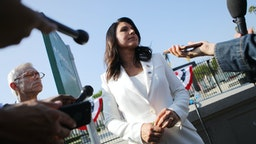 LOS ANGELES, CALIFORNIA - NOVEMBER 11: Democratic presidential candidate U.S. Rep. Tulsi Gabbard (D-HI) meets with reporters at the inaugural Veterans Day L.A. event held outside of the Los Angeles Memorial Coliseum on November 11, 2019 in Los Angeles, California. The stadium's historic torch was lit at the ceremony to mark the anniversary of the armistice which ended World War I in 1918. Gabbard is the first female combat veteran to run for the U.S. presidency. (Photo by Mario Tama/Getty Images)