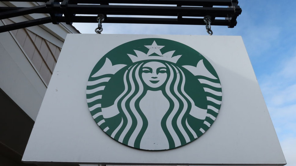 A Starbucks sign hangs in front of their store at the Woodbury Common Premium Outlets shopping mall on November 17, 2019 in Central Valley, New York.