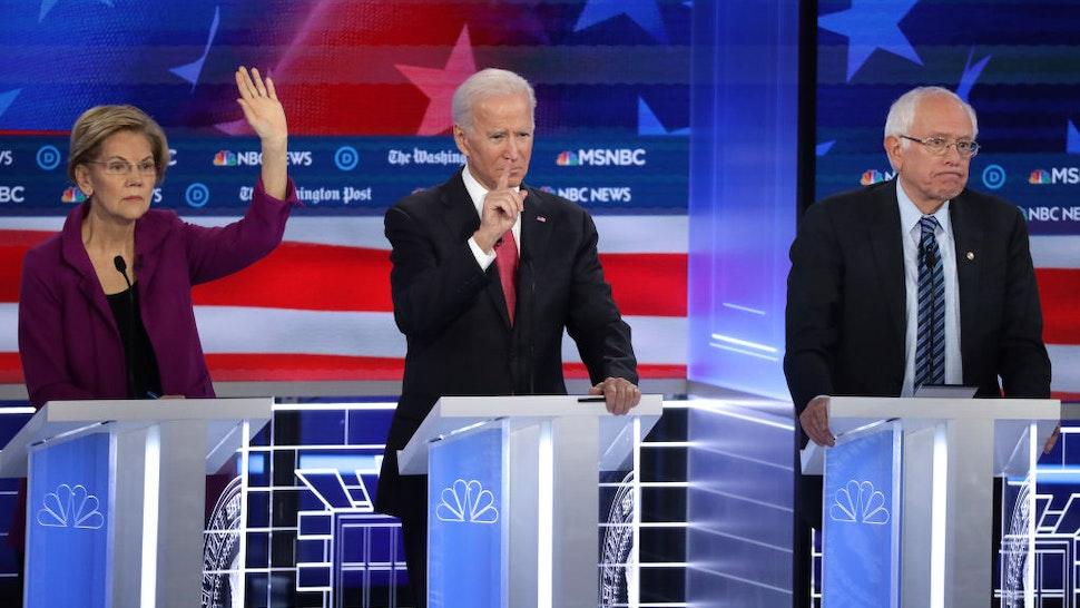 Sen. Elizabeth Warren (D-MA) (L), former Vice President Joe Biden and Sen. Bernie Sanders (I-VT) (R) participate in the Democratic Presidential Debate at Tyler Perry Studios November 20, 2019 in Atlanta, Georgia.