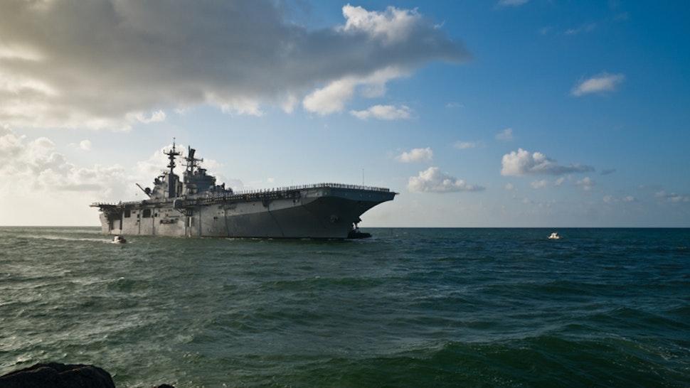 Morning sun illuminates the USS Iwo Jima (LHD-7) as she sails into Port Everglades in Fort Lauderdale, Fl..