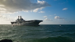 Morning sun illuminates the USS Iwo Jima (LHD-7) as she sails into Port Everglades in Fort Lauderdale, Fl..