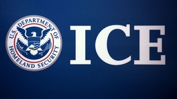 The Immigration and Customs Enforcement (ICE) seal is seen before a press conference discussing ongoing enforcement efforts to combat human smuggling along the Southwest border of the United States, July 22, 2014 at ICE headquarters in Washington, DC.