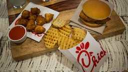 Chicken nuggets, french fries, and a fried chicken sandwich are arranged for a photograph during an event ahead of the grand opening for a Chick-fil-A restaurant in New York, U.S., on Friday, Oct. 2, 2015.