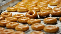 Donuts on the 270 machine at Krispy Kreme in Saco Tuesday, October 3, 2017. The 270 machine makes 270 dozen donuts per hour.