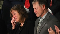 Parents of Otto Warmbier, Fred and Cindy Warmbier are acknowledged during the State of the Union address in the chamber of the U.S. House of Representatives January 30, 2018 in Washington, DC.