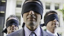 Three blindfolded businessmen - stock photo USA, California, San Francisco