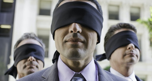 Three blindfolded businessmen - stock photo USA, California, San Francisco
