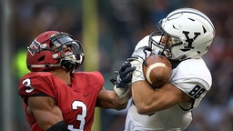 Yale Bulldogs wide receiver JP Shohfi (88) makes the reception over Harvard Crimson defensive back Tyler Gray (3) for a first down. Yale scored a field goal on the drive shortly after to take a 24-21 lead during the third quarter. Harvard hosts Yale in a college football game at Fenway Park in Boston on Nov. 17, 2018.