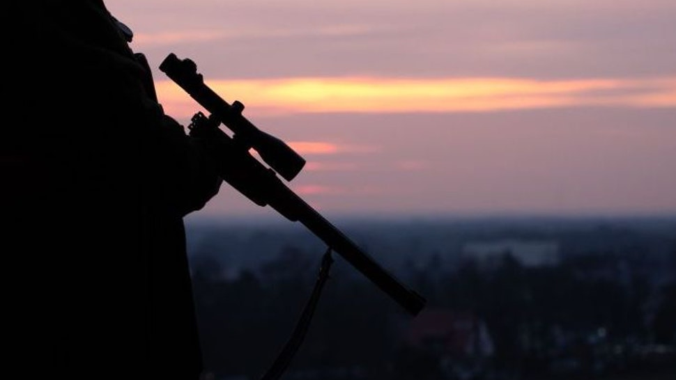 A German hunter holds his rifle on February 20, 2019 in a field in Bielefeld. (Photo by Friso Gentsch / dpa / AFP) / Germany OUT (Photo credit should read FRISO GENTSCH/DPA/AFP via Getty Images)