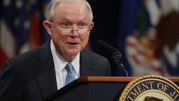 Jeff Sessions delivers remarks during a farewell ceremony for Deputy Attorney General Rod Rosenstein