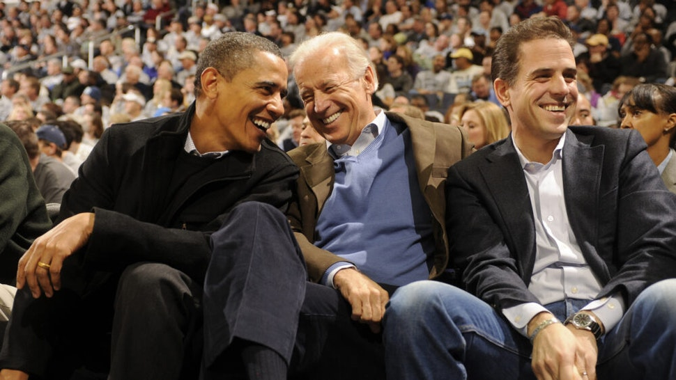 JANUARY 30: President of the United States Barack Obama and Vice President Joe Biden and Hunter Biden (son of Joe Biden) talk during a college basketball game between Georgetown Hoyas and the Duke Blue Devils on January 30, 2010 at the Verizon Center in Washington DC.