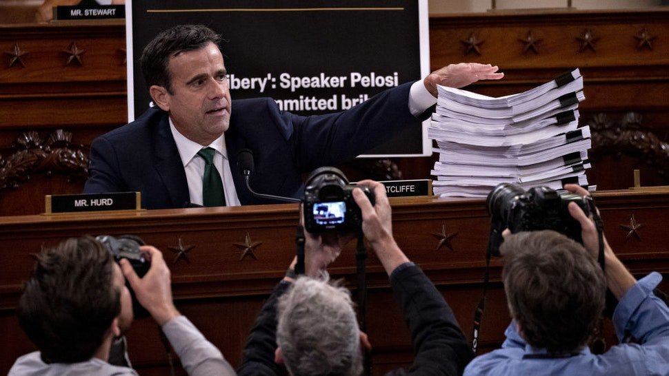 Representative John Ratcliffe, a Republican from Texas, displays a stack of sworn testimony while questioning witnesses during a House Intelligence Committee impeachment inquiry hearing in Washington, D.C., U.S., on Tuesday, Nov. 19, 2019. The committee plans to hear from eight witnesses in open hearings this week in the impeachment inquiry into President Donald Trump. Photographer: Andrew Harrer/Bloomberg