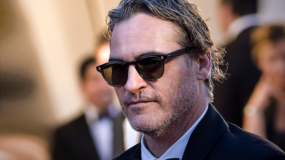 "VENICE, ITALY - AUGUST 31: Joaquin Phoenix walks the red carpet ahead of the ""Joker"" screening during the 76th Venice Film Festival at Sala Grande on August 31, 2019 in Venice, Italy."