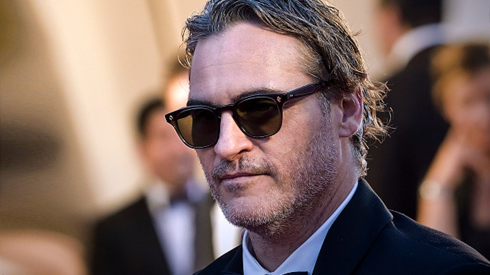 """VENICE, ITALY - AUGUST 31: Joaquin Phoenix walks the red carpet ahead of the """"Joker"""" screening during the 76th Venice Film Festival at Sala Grande on August 31, 2019 in Venice, Italy."""