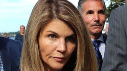 BOSTON, MA - AUGUST 27: Lori Loughlin and her husband Mossimo Giannulli, right, leave the John Joseph Moakley United States Courthouse in Boston on Aug. 27, 2019. A judge says actress Lori Loughlin and her fashion designer husband, Mossimo Giannulli, can continue using a law firm that recently represented the University of Southern California. The couple appeared in Boston federal court on Tuesday to settle a dispute over their choice of lawyers in a sweeping college admissions bribery case. Prosecutors had said their lawyers pose a potential conflict of interest. Loughlin and Giannulli say the firms work for USC was unrelated to the admissions case and was handled by different lawyers.