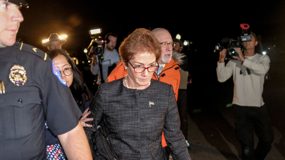 "Marie Yovanovitch, former U.S. Ambassador to Ukraine, center, leaves Capitol Hill after a closed-door deposition before House committees in Washington, D.C., U.S., on Friday, Oct. 11, 2019. Yovanovitch told House impeachment investigators Friday she was ousted after a ""concerted campaign"" by President Donald Trump and his allies, including Rudy Giuliani."