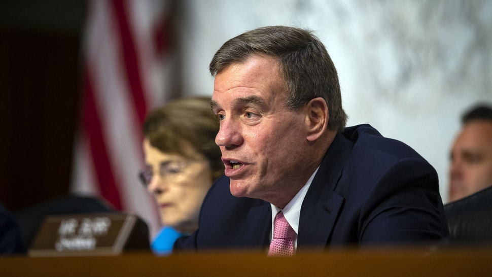 Sen. Mark Warner (D-VA), vice-chair of the Senate Intelligence Committee, questions retired Vice Adm. Joseph Maguire at his confirmation hearing, to become the director of the National Counterterrorism Center, on Capitol Hill, on July 25, 2018 in Washington, DC.