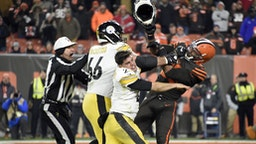 CLEVELAND, OHIO - NOVEMBER 14: Quarterback Mason Rudolph #2 of the Pittsburgh Steelers fights with defensive end Myles Garrett #95 of the Cleveland Browns during the second half at FirstEnergy Stadium on November 14, 2019 in Cleveland, Ohio. The Browns defeated the Steelers 21-7.