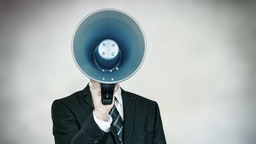 Man yells into megaphone
