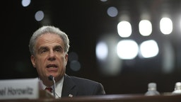 Justice Department Inspector General Michael Horowitz testifies before the Senate Judiciary Committee on Capitol Hill June 18, 2018 in Washington, DC. According to a report by Justice Department Inspector General Horowitz, former FBI Director James Comey and other top officials did not follow standard procedures in their handling of the 2016 investigation into Hillary Clinton's email server, but did not find any evidence of political bias. (Photo by Win McNamee/Getty Images)