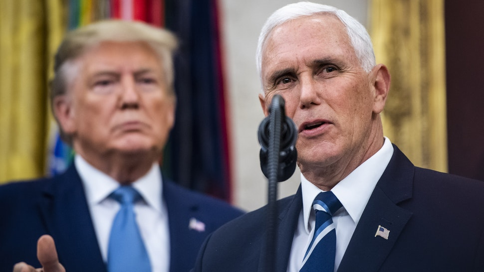 WASHINGTON, DC - OCTOBER 8 : President Donald J. Trump listens to Vice President Mike Pence speak during a ceremony to award the Presidential Medal of Freedom to Edwin Meese III in the Oval Office at the White House on Tuesday, Oct 08, 2019 in Washington, DC.