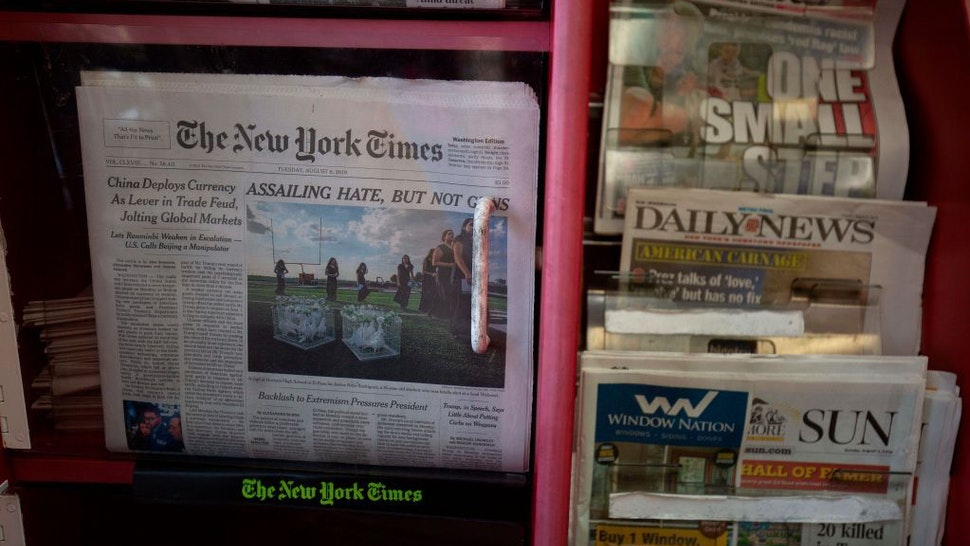 The front pages of The New York Times, New York Post, New York Daily News and Baltimore Sun newspapers are seen at a convenience store in Washington, DC, on August 6, 2019. (Photo by Alastair Pike / AFP) (Photo credit should read ALASTAIR PIKE/AFP via Getty Images)