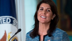 US Ambassador to the United Nation Nikki Haley smiles at the US Department of State in Washington DC on June 19, 2018. - The United States announced that it is withdrawing from the UN Human Rights Council. (Photo by Andrew CABALLERO-REYNOLDS / AFP) (Photo credit should read ANDREW CABALLERO-REYNOLDS/AFP via Getty Images)