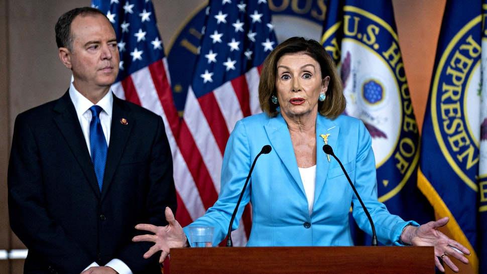 U.S. House Speaker Nancy Pelosi, a Democrat from California, speaks as Representative Adam Schiff, a Democrat from California and chairman of the House Intelligence Committee, left, listens during a news conference on Capitol Hill in Washington, D.C., U.S., on Wednesday, Oct. 2, 2019. Three House committee chairmen threatened on Wednesday to subpoena the White House if it fails to adhere by Friday to document requests related to allegations that President Donald Trump pressured Ukraine into investigating one of his leading political rivals.