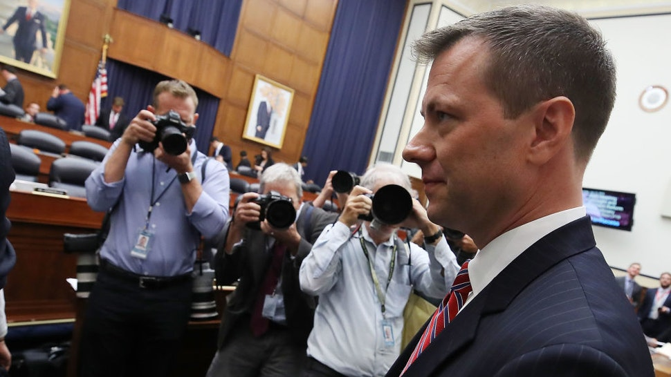 Deputy Assistant FBI Director Peter Strzok walks away during a break in a joint committee hearing of the House Judiciary and Oversight and Government Reform committees in the Rayburn House Office Building on Capitol Hill July 12, 2018 in Washington, DC. While involved in the probe into Hillary ClintonÕs use of a private email server in 2016, Strzok exchanged text messages with FBI attorney Lisa Page that were critical of Trump. After learning about the messages, Mueller removed Strzok from his investigation into whether the Trump campaign colluded with Russia to win the 2016 presidential election.Ê (Photo by Mark Wilson/Getty Images)