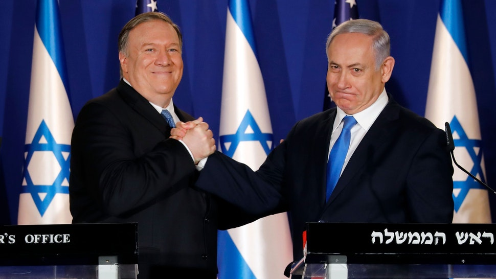 Israeli Prime Minister Benjamin Netanyahu (R) welcomes US Secretary of State Mike Pompeo to his residence in Jerusalem on March 21, 2019. - Pompeo issued a thinly veiled jab at US Democrats over anti-Semitism, following controversial comments by a Muslim congresswoman over American support for Israel.