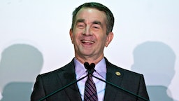 Ralph Northam, governor of Virginia, smiles while speaking during news conference in Arlington, Virginia, U.S., on Tuesday, Nov. 13, 2018. Amazon.com Inc. will build new offices in New York City and Arlington, ending months of jockeying between potential locations across the country vying for a $5 billion investment that promises 50,000 high-paying jobs over almost two decades.