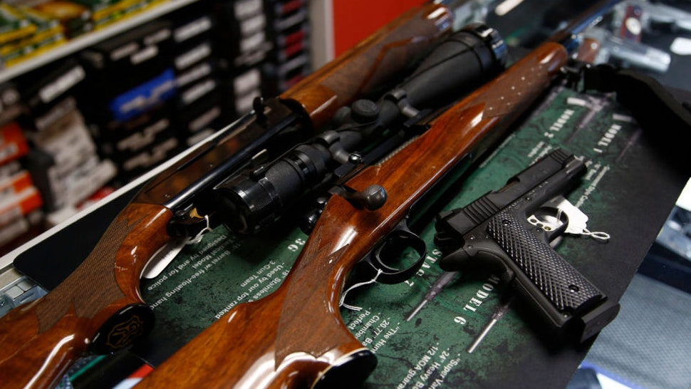 STOKESDALE, NC - MARCH 26: A Remington 700 hunting rifle, a Remington 1100 shotgun and a Remington R1 Enhanced model 1911 pistol are seen for sale at Atlantic Outdoors gun shop on March 26, 2018 in Stokesdale, North Carolina. Founded in 1816, Remington is one of America's oldest gun and ammunition manufacturers which now has filed for Chapter 11 bankruptcy protection partially due to an estimated $950 million in debt.