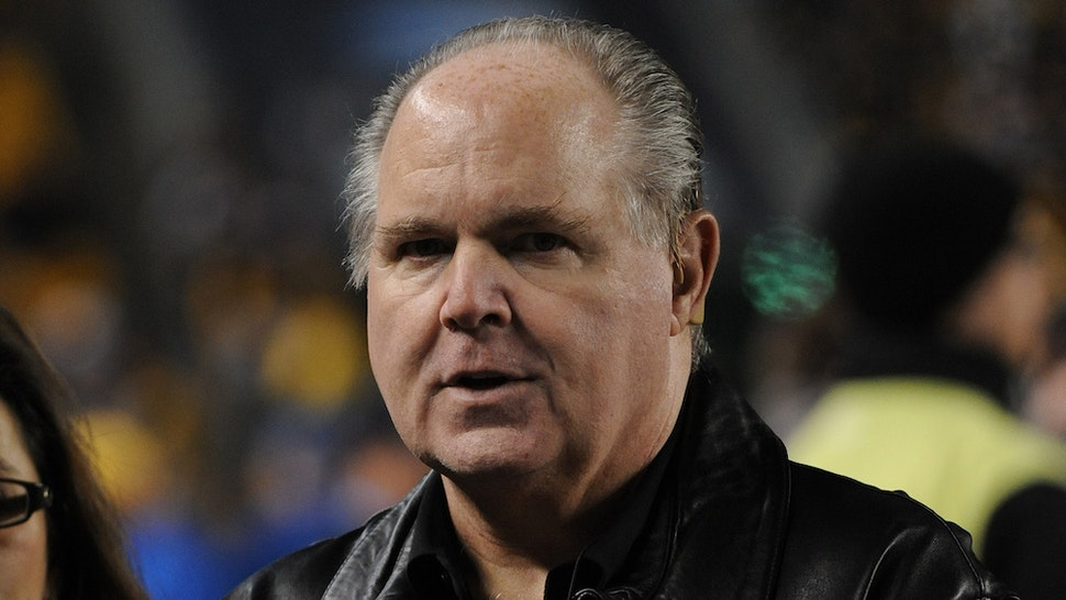 Radio talk show host and political commentator Rush Limbaugh looks on from the sideline before a National Football League game between the Baltimore Ravens and Pittsburgh Steelers at Heinz Field on November 6, 2011 in Pittsburgh, Pennsylvania. The Ravens defeated the Steelers 23-20. (Photo by George Gojkovich/Getty Images)