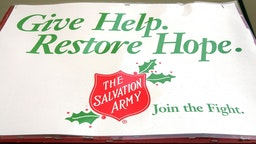 CHICAGO - DECEMBER 2: The Salvation Army creed is seen on a bell ringer's pole in front of a Kmart store December 2, 2004 in Chicago, Illinois. Several major national retailers have banned Salvation Army bell ringers, including Target stores.