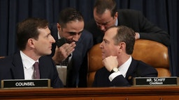 Majority counsel for the House Intelligence Committee Daniel Goldman (lower left) and House Intelligence Committee Chairman Rep. Adam Schiff (lower right) (D-CA) confer as top U.S. diplomat to Ukraine, William B. Taylor Jr., and Deputy Assistant Secretary for European and Eurasian Affairs George P. Kent testify before the House Intelligence Committee in the Longworth House Office Building on Capitol Hill November 13, 2019 in Washington, DC. In the first public impeachment hearings in more than two decades, House Democrats are making a case that President Donald Trump committed extortion, bribery or coercion by trying to enlist Ukraine to investigate political rivals in exchange for military aid and a White House meeting that Ukraine President Volodymyr Zelensky sought with Trump. (