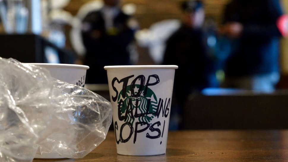 Protesters gather on April 16, 2018 for ongoing protest at the Starbucks location in Center City Philadelphia, PA where days earlier two black men were arrested. Starbucks CEO Kevin Johnson apologized publicly after the arrest prompted controversy after video of the incident became viral. (Photo by Bastiaan Slabbers/NurPhoto)