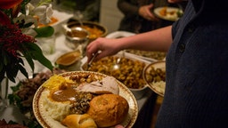 Unidentified diners serve themselves food at a traditional Thanksgiving Day family gathering in Bloomfield Hills, Michigan on November 26, 2015.