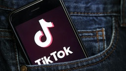 PARIS, FRANCE - MARCH 05: In this photo illustration, the social media application logo, Tik Tok is displayed on the screen of an iPhone on March 05, 2019 in Paris, France. The social network broke the rules for the protection of children's online privacy (COPPA) and was fined $ 5.7 million. The fact TikTok criticized is quite serious in the United States, the platform, which currently has more than 500 million users worldwide, collected data that should not have asked minors. TikTok, also known as Douyin in China, is a media app for creating and sharing short videos. Owned by ByteDance, Tik Tok is a leading video platform in Asia, United States, and other parts of the world. In 2018, the application gained popularity and became the most downloaded app in the U.S. in October 2018.