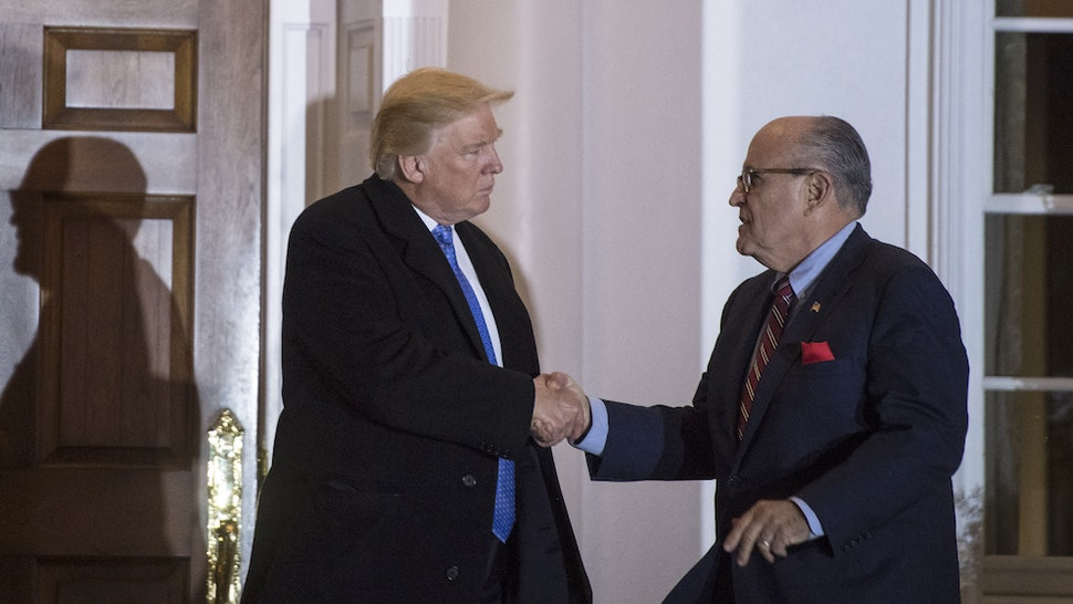 President-elect Donald Trump talks with Rudy Giuliani after a meeting at the clubhouse at Trump National Golf Club Bedminster in Bedminster Township, N.J. on Sunday, Nov. 20, 2016. (Photo by Jabin Botsford/The Washington Post via Getty Images)