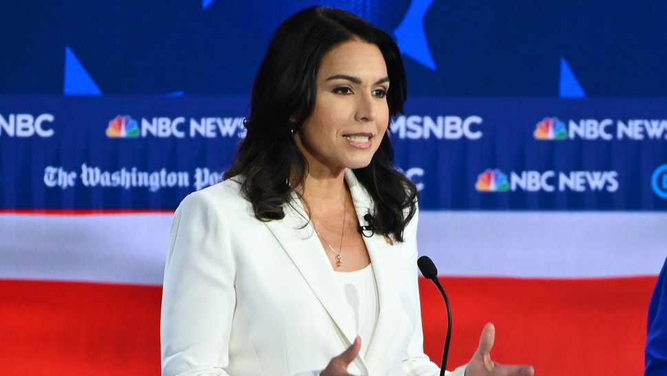 Democratic presidential hopefuls Representative for Hawaii Tulsi Gabbard (L) speaks as Minnesota Senator Amy Klobuchar listens during the fifth Democratic primary debate of the 2020 presidential campaign season co-hosted by MSNBC and The Washington Post at Tyler Perry Studios in Atlanta, Georgia on November 20, 2019.