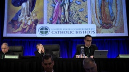 Reverend Jose Gomez (Top L), Archbishop of Los Angeles and Vice President of the USCCB General Assembly, Cardinal Daniel DiNardo (Top C), President of the USCCB General Assembly, Reverend Monsignor J. Brian Bransfield (Top R), General Secretary of the USCCB General Assembly, and others wait for an opening session during the annual US Conference of Catholic Bishops November 12, 2018 in Baltimore, Maryland.