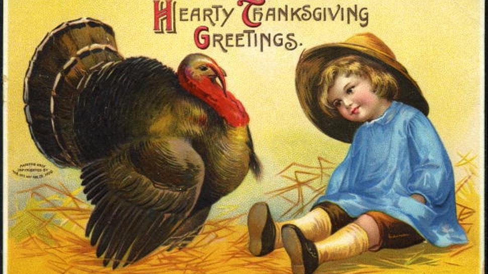 A postcard painting shows a child looking at a Thanksgiving turkey, 1909. Published by the International Art Publishing Company, the text reads 'Hearty Thanksgiving Greetings.'
