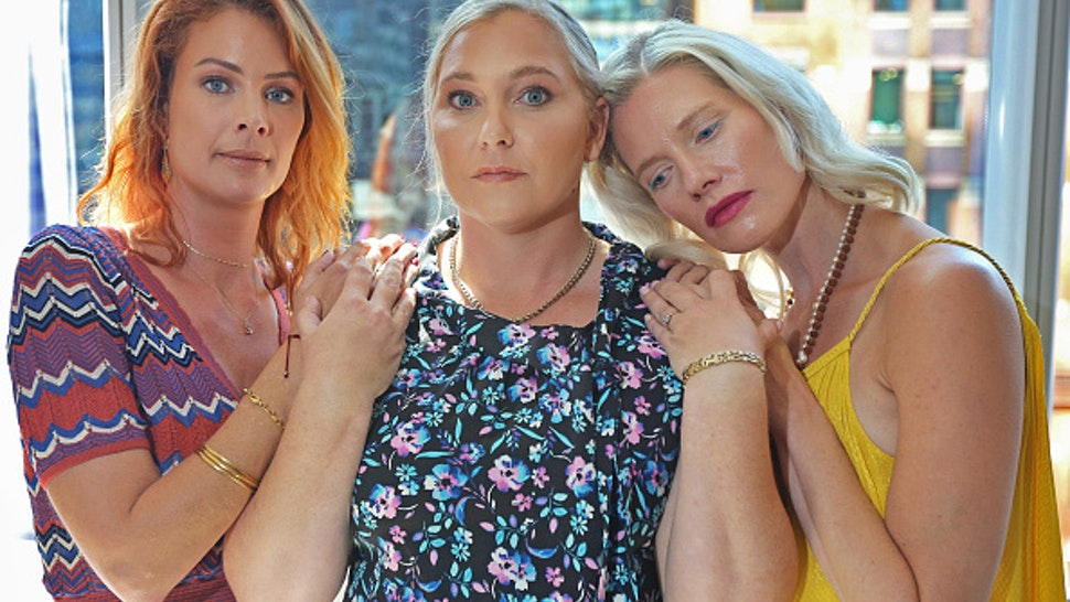Victims of Jeffrey Epstein, from left, Sarah Ransome, Virginia Roberts Giuffre, and Marijke Chartouni find support in each other after having met at an emotional court hearing for victims of Epstein on August 27, 2019. The three young women had never met before the hearing but said during an interview two days later that the hearing had helped them bond with other women who had suffered similar abuses by Epstein and his co-conspirators.