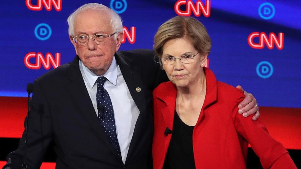 Democratic presidential candidate Sen. Bernie Sanders (I-VT) (L) and Sen. Elizabeth Warren (D-MA) embrace after the Democratic Presidential Debate at the Fox Theatre July 30, 2019 in Detroit, Michigan.