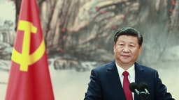 BEIJING, CHINA - OCTOBER 25: Chinese President Xi Jinping speaks at the podium during the unveiling of the Communist Party's new Politburo Standing Committee at the Great Hall of the People on October 25, 2017 in Beijing, China. China's ruling Communist Party today revealed the new Politburo Standing Committee after its 19th congress.