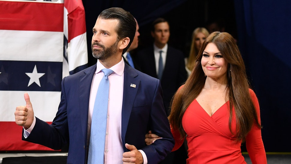 Kimberly Guilfoyle (R) and Donald Trump Jr. arrive at a rally for US President Donald Trump, to officially launch the Trump 2020 campaign, at the Amway Center in Orlando, Florida on June 18, 2019. - Trump kicks off his reelection campaign at what promised to be a rollicking evening rally in Orlando.