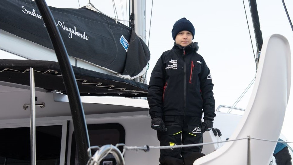 """Swedish climate activist Greta Thunberg stands aboard the catamaran La Vagabonde as she sets sail to Europe in Hampton, Virginia, on November 13, 2019. - """"Extremely educational"""" is how Greta Thunberg sums up her North American sojourn as she prepares to cross the Atlantic once more, this time bound back for Europe. The 16-year-old Swede, who became world famous for founding the """"school strikes for the climate,"""" will set sail Wednesday morning, weather permitting, after 11 hectic weeks of criss-crossing the US and Canada, making headlines at every turn."""