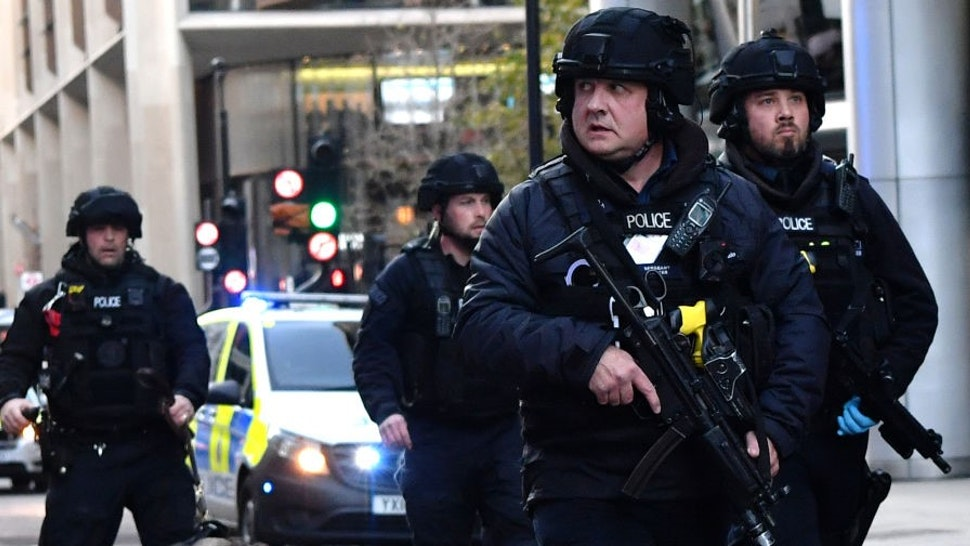 TOPSHOT - Armed police with dogs patrol along Cannon Street in central London, on November 29, 2019 after reports of shots being fired on London Bridge. - The Metropolitan Police on Friday said several people were injured and a man was held after a stabbing near London Bridge in the centre of the British capital. (Photo by Ben STANSALL / AFP) (Photo by
