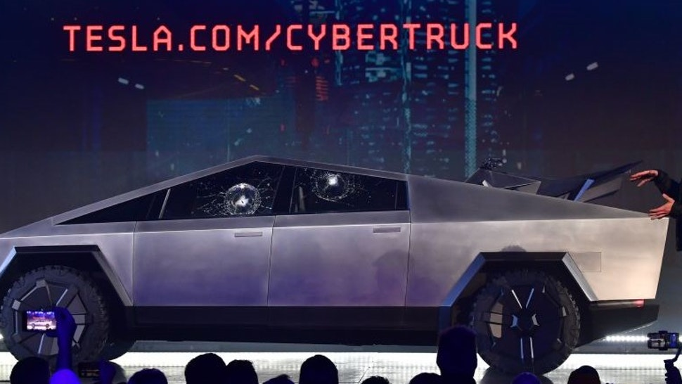 Tesla co-founder and CEO Elon Musk gestures while wrapping up his presentation of the newly unveiled all-electric battery-powered Tesla Cybertruck at Tesla Design Center in Hawthorne, California on November 21, 2019.